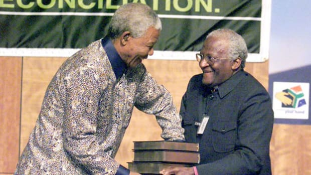 On October 29, 1998, South Africa's Truth and Reconciliation Commission, headed by Archbishop Desmond Tutu, released its final report about crimes and atrocities that occurred during apartheid. Upon presenting the 3,500-page report to Nelson Mandela, Archbishop Tutu delivers a speech focusing on healing the divided country.