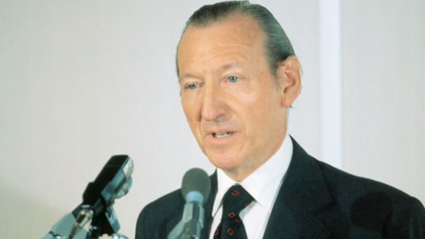 U.N. Secretary General Kurt Waldheim congratulates the American and Soviet astronauts for the Apollo-Soyuz Test Project. On July 17, 1975, Commanders Thomas P. Safford and Aleksei Leonov shook hands in space.