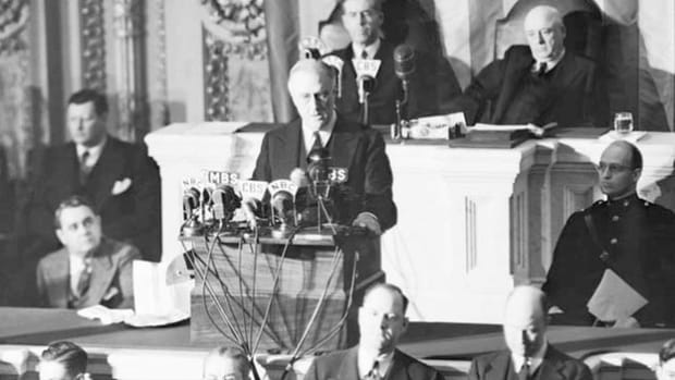 On the day after the December 7, 1941, attack on Pearl Harbor, President Roosevelt tells a joint session of Congress that the United States must take up arms in response.