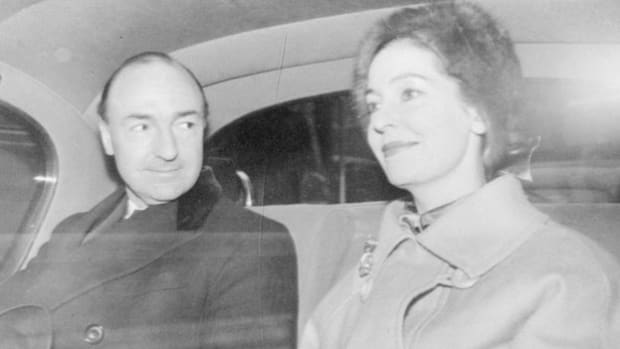 In 1963, a scandal gripped British Prime Minister Harold Macmillan's government when it was alleged that his secretary of war, John Profumo, engaged in an affair with 19-year-old Christine Keeler, who was also having an affair with an attache at the Soviet Embassy. A news report describes the outcome following the release of the official report on the scandal.
