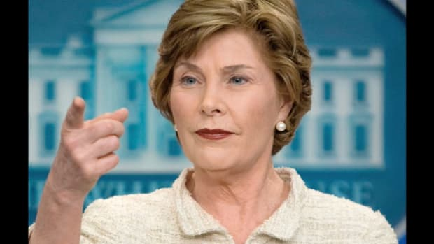 On May 3, 2008, Cyclone Nargis hit Myanmar, formerly known as Burma, causing major damage and a massive death toll. Speaking from the White House on May 5 in her first press conference, first lady Laura Bush criticizes the country's military government for failure to warn its citizens of the impending storm.