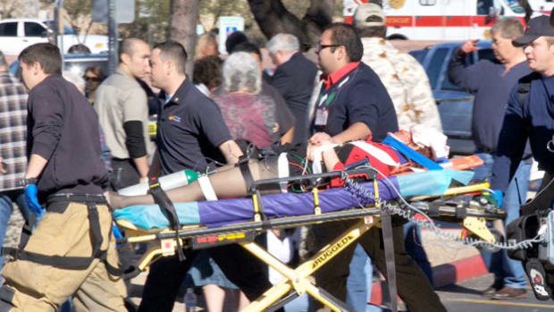 An eyewitness to the January 8, 2011, shooting of Rep. Gabrielle Giffords and 13 others recounts the tragedy as it unfolded. In the assassination attempt, the gunman, later identified as Jared L. Loughner, shot Rep. Giffords in the head and killed six others in a group gathered for a town hall-style event outside a supermarket in Tucson, Arizona.