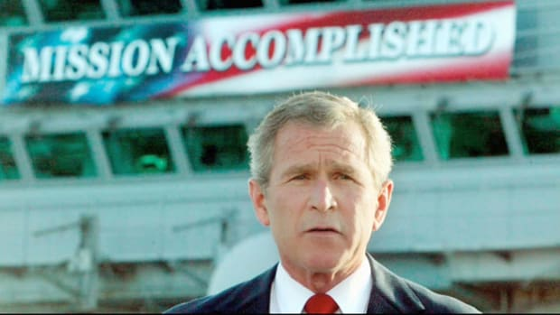 "From aboard the aircraft carrier USS Abraham Lincoln on May 1, 2003, standing directly under a ""Mission Accomplished"" banner, President George W. Bush declares, ""In the battle of Iraq, the United States and our allies have prevailed."" Bush's claim of victory in what became known as the ""Mission Accomplished"" speech drew criticism as the war in Iraq continued for several years thereafter."