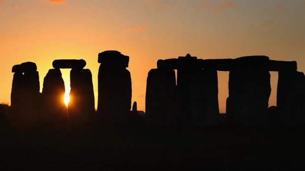 How and why did prehistoric man build the massive stone structures at Stonehenge?
