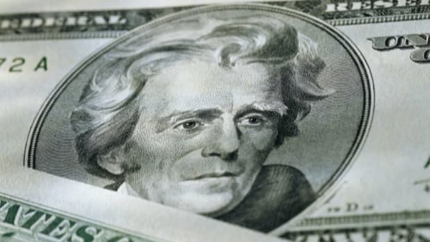 Why is Andrew Jackson--a staunch opponent of paper money--featured on the $20 bill?