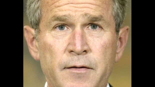 At a White House ceremony on October 16, 2002, President George W. Bush signs the resolution passed by Congress the previous week to authorize the use of force if Iraq fails to comply with new weapons inspections.