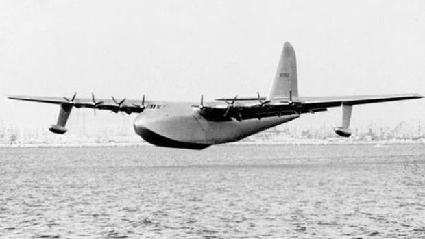 "On November 2, 1947, in live coverage from aboard the world's largest aircraft, Los Angeles' KLAC reporter James McNamara describes the first and only flight of Hughes' Flying Boat, dubbed the ""Spruce Goose"" because it was constructed entirely of wood. McNamara, who thought the plane would only be running taxi tests, expresses his surprise when the craft briefly becomes airborne."