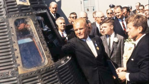 On February 20, 1962, Lt. Col. John H. Glenn Jr. became the first American astronaut to orbit Earth. Within minutes of Glenn's safe emergence from his Mercury capsule, President John F. Kennedy tells the nation that America has reached a new ocean  in its race to space.