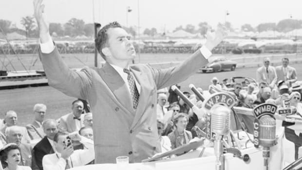 As a candidate for vice president, Sen. Richard Nixon delivers a speech at a political rally in Sanford, Maine, on September 3, 1952, and promises that he will take care of the communist problem plaguing the federal government.