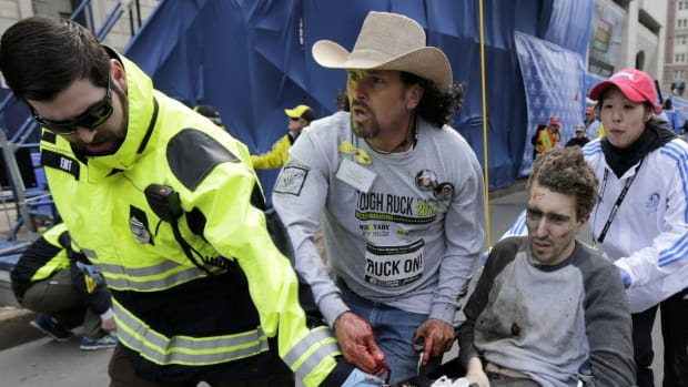 "Personal tragedy brought Carlos Arredondo, ""the man in the cowboy hat,"" to the finish line that day, but his spontaneous act of heroism helped save a life and change the course of the investigation into the attack."