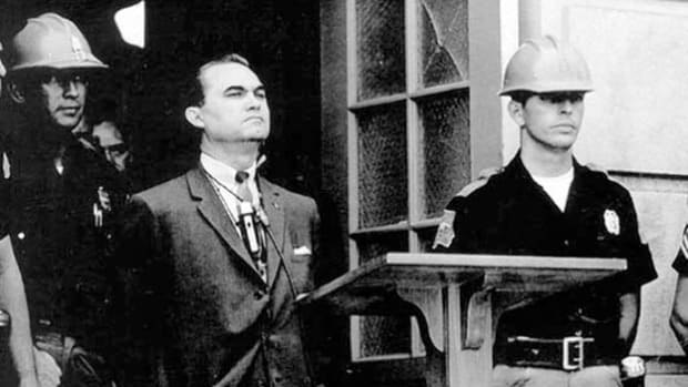 Gov. George Wallace holds a press conference to argue against integration of the state's public schools. Almost 10 years after the U.S. Supreme Court ruling to desegregate schools, Alabama had still not complied. On June 11, 1963, Wallace made national news when he stood in the doorway at the University of Alabama to block African-American students from entering.