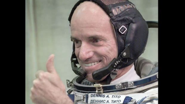 Upon his return to Earth from the International Space Station on May 9, 2001, California millionaire Dennis Tito speaks at a press conference about his experience as the world's first space tourist. The tycoon reportedly paid the Russian space program $20 million for the trip into outer space.
