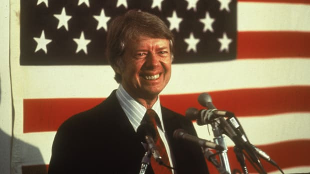 "On this day in 1980, in a strong reaction to the December 1979 Soviet invasion of Afghanistan, President Jimmy Carter asks the Senate to postpone action on the SALT II nuclear weapons treaty and recalls the U.S. ambassador to Moscow. These actions sent a message that the age of detente and the friendlier diplomatic and economic relations that were established between the United States and Soviet Union during President Richard Nixon's administration (1969-74) had ended. Carter feared that the Soviet invasion of Afghanistan, in which an estimated 30,000 combat troops entered that nation and established a puppet government, would threaten the stability of strategic neighboring countries such as Iran and Pakistan and could lead to the USSR gaining control over much of the world's oil supplies. The Soviet actions were labeled ""a serious threat to peace"" by the White House. Carter asked the Senate to shelve ratification talks on SALT II, the nuclear arms treaty that he and Soviet Premier Leonid Brezhnev had already signed, and the president called U.S. ambassador to Moscow Thomas J. Watson back to Washington for ""consultation,"" in an effort to let the Kremlin know that military intervention in Afghanistan was unacceptable. When the Soviets refused to withdraw from Afghanistan, America halted certain key exports to the USSR, including grain and high technology, and boycotted the 1980 summer Olympics, which were held in Moscow. The United States also began to covertly subsidize anti-Soviet fighters in Afghanistan. During Ronald Reagan's presidency in the 1980s, the CIA secretly sent billions of dollars to Afghanistan to arm and train the mujahedeen rebel forces that were battling the Soviets. This tactic was successful in helping to drive out the Soviets, but it also gave rise to the oppressive Taliban regime and Osama bin Laden's al-Qaida terrorist organization."