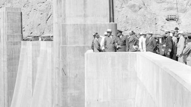 On September 30, 1935, U.S. Secretary of the Interior Harold L. Ickes formally dedicates the Hoover Dam during a ceremony attended by President Franklin D. Roosevelt. The dam was built by thousands of workers in one of America's most inhospitable environments.
