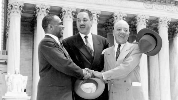 "On May 17, 1954, U.S. Supreme Court Chief Justice Earl Warren delivered the unanimous ruling against the ""separate but equal"" mandate and demanded desegregation of schools. Outside the courtroom, the attorneys who argued the Brown v. Board of Education case, James Nabrit Jr., Thurgood Marshall and George Hayes, give a press conference."