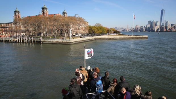 On this day in 1954, Ellis Island, the gateway to America, shuts it doors after processing more than 12 million immigrants since opening in 1892. Today, an estimated 40 percent of all Americans can trace their roots through Ellis Island, located in New York Harbor off the New Jersey coast and named for merchant Samuel Ellis, who owned the land in the 1770s. On January 2, 1892, 15-year-old Annie Moore, from Ireland, became the first person to pass through the newly opened Ellis Island, which President Benjamin Harrison designated as America's first federal immigration center in 1890. Before that time, the processing of immigrants had been handled by individual states. Not all immigrants who sailed into New York had to go through Ellis Island. First- and second-class passengers submitted to a brief shipboard inspection and then disembarked at the piers in New York or New Jersey, where they passed through customs. People in third class, though, were transported to Ellis Island, where they underwent medical and legal inspections to ensure they didn't have a contagious disease or some condition that would make them a burden to the government. Only two percent of all immigrants were denied entrance into the U.S. Immigration to Ellis Island peaked between 1892 and 1924, during which time the 3.3-acre island was enlarged with landfill and additional buildings were constructed to handle the massive influx of immigrants. During the busiest year of operation, 1907, over 1 million people were processed at Ellis Island. After 1924, Ellis Island switched from a processing center to serving other purposes, such as a detention and deportation center for illegal immigrants, a hospital for wounded soldiers during World War II and a Coast Guard training center. In November 1954, the last detainee, a Norwegian merchant seaman, was released and Ellis Island officially closed.