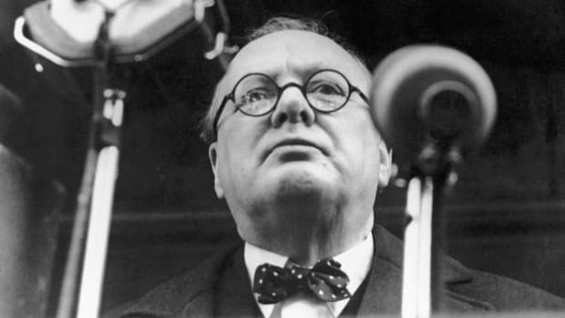 """On the final day of the evacuation of Dunkirk, June 4, 1940, Prime Minister Winston Churchill speaks before the House of Commons, triumphant over the rescue of 338,226 Allied troops from advancing German forces. In the address he warns the nation to expect a German invasion and defiantly declares that Hitler's troops will meet an enemy prepared to """"defend our island whatever the cost may be."""""""