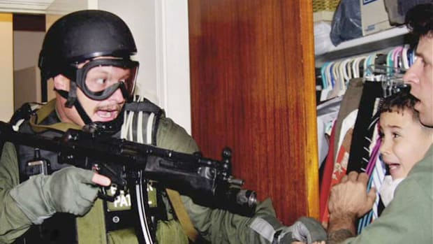 A news bulletin depicts the latest dramatic scene in the Elian Gonzalez saga, in which U.S. federal agents stormed the Miami house where the 6-year-old refugee was staying on April 22, 2000. On November 25, 1999, Gonzales was found floating on an inner tube off the Florida coast. His ensuing custody battle turned into a controversy between the governments of the United States and Cuba.