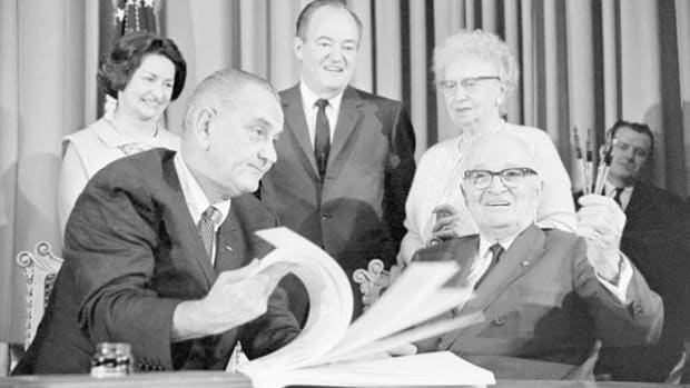 On July 30, 1965, President Lyndon B. Johnson joined former President Harry Truman in Independence, Missouri, to sign the Medicare Bill into law. In his remarks following the signing of the document, President Johnson credits Presidents FDR and Truman with paving the way for the bill.