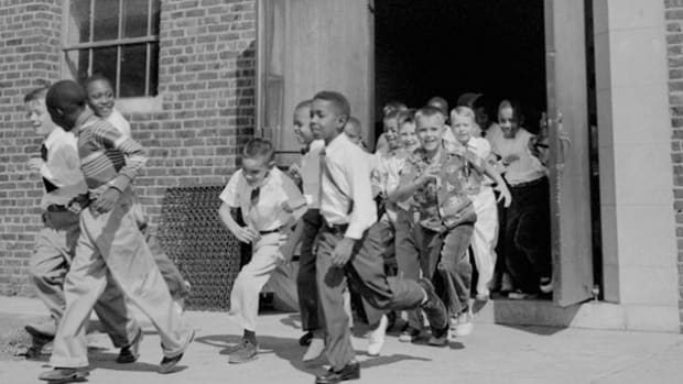 On May 17, 1954, the U.S. Supreme Court ruled unanimously that racial segregation in public schools was unconstitutional. A commentary on the ruling explores the differing theories on integration at the time.