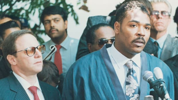 "Following the April 29, 1992, verdict in which four white Los Angeles Police Department officers were acquitted of charges in the beating of black motorist Rodney King, riots broke out across Los Angeles. On May 1, 1992, King pleads with citizens to stop the violence and ""get along."""