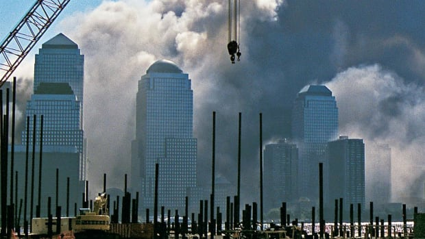 Running for safety after One World Trade Center's collapse.  Courtesy of WCBS Newsradio 880.