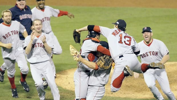 After an 86-year stretch since their last championship, the Boston Red Sox win the World Series on October 27, 2004, defeating the St. Louis Cardinals. The historic moment is captured in news coverage of game four.