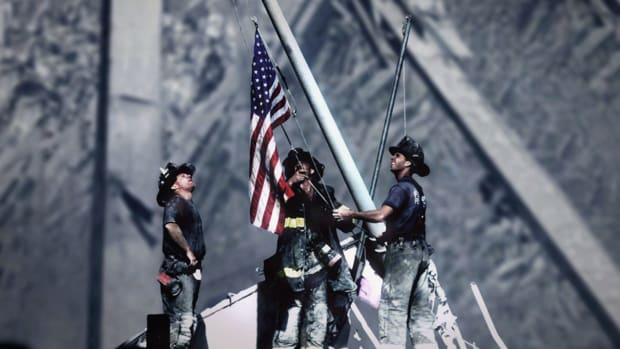 What happened to the flag hoisted at Ground Zero on September 11, 2001?