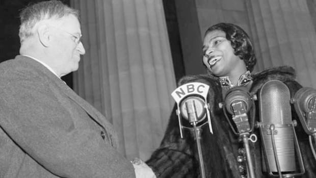 Secretary of the Interior Harold L. Ickes stresses racial equality in his introduction of African-American singer Marian Anderson, who performs a concert on April 9, 1939, at the Lincoln Memorial in Washington, D.C. Anderson had previously been denied a booking at Washington's Constitution Hall because of her race. In the wake of public outrage, Ickes stepped in and secured Anderson's performance at the memorial.