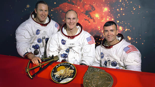 "On this day in 1970, with the world anxiously watching, Apollo 13, a U.S. lunar spacecraft that suffered a severe malfunction on its journey to the moon, safely returns to Earth. On April 11, the third manned lunar landing mission was launched from Cape Canaveral, Florida, carrying astronauts James A. Lovell, John L. Swigert, and Fred W. Haise. The mission was headed for a landing on the Fra Mauro highlands of the moon. However, two days into the mission, disaster struck 200,000 miles from Earth when oxygen tank No. 2 blew up in the spacecraft. Mission commander Lovell reported to mission control on Earth: ""Houston, we've had a problem here,"" and it was discovered that the normal supply of oxygen, electricity, light, and water had been disrupted. The landing mission was aborted, and the astronauts and controllers on Earth scrambled to come up with emergency procedures. The crippled spacecraft continued to the moon, circled it, and began a long, cold journey back to Earth. The astronauts and mission control were faced with enormous logistical problems in stabilizing the spacecraft and its air supply, as well as providing enough energy to the damaged fuel cells to allow successful reentry into Earth's atmosphere. Navigation was another problem, and Apollo 13's course was repeatedly corrected with dramatic and untested maneuvers. On April 17, tragedy turned to triumph as the Apollo 13 astronauts touched down safely in the Pacific Ocean."