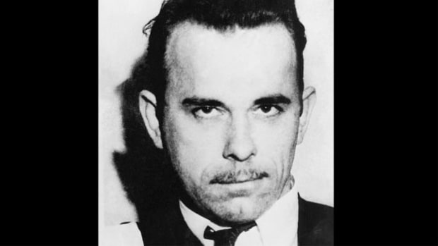 A 1934 report informs the nation that its public enemy number one, John Dillinger, has been killed. Betrayed by his girlfriend, who tipped off police about his whereabouts, Dillinger was gunned down as he left Chicago's Biograph Theater on July 22.