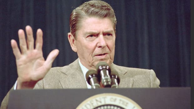 "After the Iran-Contra scandal is exposed in November 1986, President Ronald Reagan announces to the nation that he would ""welcome the appointment of an independent counsel"" to investigate matters. The Iran-Contra Affair involved the secret selling of arms to Iran in exchange for the release of hostages. The money from the arms sales was then used to secretly support the Contras in their battle against the Sandinista government of Nicaragua."