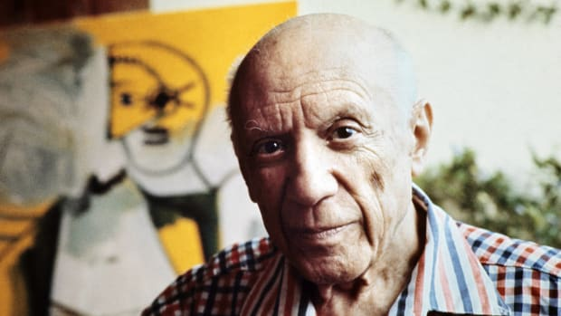 "On this day in 1881, Pablo Picasso, one of the greatest and most influential artists of the 20th century, is born in Malaga, Spain. Picasso's father was a professor of drawing, and he bred his son for a career in academic art. Picasso had his first exhibit at age 13 and later quit art school so he could experiment full-time with modern art styles. He went to Paris for the first time in 1900, and in 1901 was given an exhibition at a gallery on Paris' rue Lafitte, a street known for its prestigious art galleries. The precocious 19-year-old Spaniard was at the time a relative unknown outside Barcelona, but he had already produced hundreds of paintings. Winning favorable reviews, he stayed in Paris for the rest of the year and later returned to the city to settle permanently. The work of Picasso, which comprises more than 50,000 paintings, drawings, engravings, sculptures, and ceramics produced over 80 years, is described in a series of overlapping periods. His first notable period--the ""blue period""--began shortly after his first Paris exhibit. In works such as The Old Guitarist (1903), Picasso painted in blue tones to evoke the melancholy world of the poor. The blue period was followed by the ""rose period,"" in which he often depicted circus scenes, and then by Picasso's early work in sculpture. In 1907, Picasso painted the groundbreaking work Les Demoiselles d'Avignon, which, with its fragmented and distorted representation of the human form, broke from previous European art. Les Demoiselles d'Avignon demonstrated the influence on Picasso of both African mask art and Paul CEzanne and is seen as a forerunner of the Cubist movement, founded by Picasso and the French painter Georges Braque in 1909."