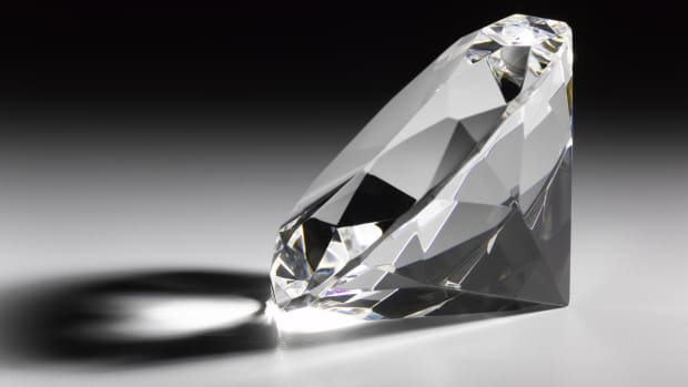 "On this day in 1905, at the Premier Mine in Pretoria, South Africa, a 3,106-carat diamond is discovered during a routine inspection by the mine's superintendent. Weighing 1.33 pounds, and christened the ""Cullinan,"" it was the largest diamond ever found. Frederick Wells was 18 feet below the earth's surface when he spotted a flash of starlight embedded in the wall just above him. His discovery was presented that same afternoon to Sir Thomas Cullinan, who owned the mine. Cullinan then sold the diamond to the Transvaal provincial government, which presented the stone to Britain's King Edward VII as a birthday gift. Worried that the diamond might be stolen in transit from Africa to London, Edward arranged to send a phony diamond aboard a steamer ship loaded with detectives as a diversionary tactic. While the decoy slowly made its way from Africa on the ship, the Cullinan was sent to England in a plain box. Edward entrusted the cutting of the Cullinan to Joseph Asscher, head of the Asscher Diamond Company of Amsterdam. Asscher, who had cut the famous Excelsior Diamond, a 971-carat diamond found in 1893, studied the stone for six months before attempting the cut. On his first attempt, the steel blade broke, with no effect on the diamond. On the second attempt, the diamond shattered exactly as planned; Asscher then fainted from nervous exhaustion. The Cullinan was later cut into nine large stones and about 100 smaller ones, valued at millions of dollars all told. The largest stone is called the ""Star of Africa I,"" or ""Cullinan I,"" and at 530 carats, it is the largest-cut fine-quality colorless diamond in the world. The second largest stone, the ""Star of Africa II"" or ""Cullinan II,"" is 317 carats. Both of these stones, as well as the ""Cullinan III,"" are on display in the Tower of London with Britain's other crown jewels; the Cullinan I is mounted in the British Sovereign's Royal Scepter, while the Cullinan II sits in the Imperial State Crown."