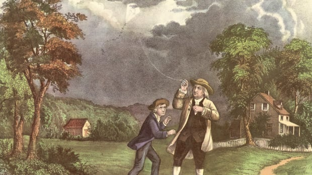 In This Day in History video clip: On this day in 1752, Benjamin Franklin flies a kite during a thunderstorm and collects a charge in a Leyden jar when the kite is struck by lightning, enabling him to demonstrate the electrical nature of lightning. Franklin became interested in electricity in the mid-1740s, a time when much was still unknown on the topic, and spent almost a decade conducting electrical experiments. He coined a number of terms used today, including battery, conductor, and electrician. He also invented the lightning rod, used to protect buildings and ships.
