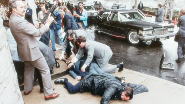 On March 30, 1980, two months after he took office, President Reagan was shot by John W. Hinckley Jr. in an assassination attempt. The Secret Service communicates by radio as the scene unfolds, first describing Reagan (code-named Rawhide) as being okay, then coming to the realization that he is hurt and must be taken to the hospital.