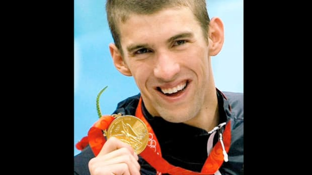 An August 17, 2008, CBS news report highlights the new Olympic record set by Michael Phelps, who won eight gold medals in eight swimming events, breaking Mark Spitz's standing 36-year record of seven gold medals.