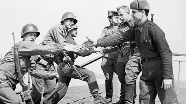 NBC News war coverage details the Allied success at the Elbe. On April 25, 1945, American and Russian troops converged at the Elbe River in Germany. By joining forces, the American and Soviet troops dealt a damaging blow to the Germans by cutting their army in two.