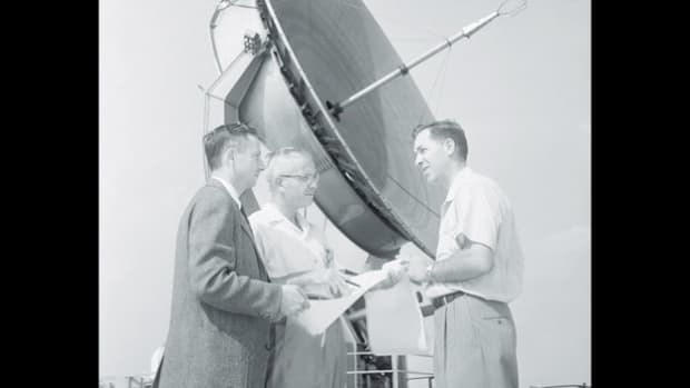 In a 1960 broadcast, a Voice of America reporter interviews Dr. Campbell Wade of the National Radio Astronomical Observatory about his discoveries analyzing radio waves to see 1 billion light years into space and about the possibility of life on other planets.