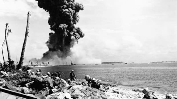 In a live recording, Sgt. Fred Walker gives a blow-by-blow description of a battle with Japanese forces as he lands on one of the Marshall Island atolls in the Pacific with the Marines Fifth Amphibian Corps in 1944.