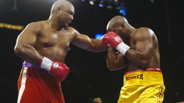 "On this day in 1994, George Foreman, age 45, becomes boxing's oldest heavyweight champion when he defeats 26-year-old Michael Moorer in the 10th round of their WBA fight in Las Vegas. More than 12,000 spectators at the MGM Grand Hotel watched Foreman dethrone Moorer, who went into the fight with a 35-0 record. Foreman dedicated his upset win to ""all my buddies in the nursing home and all the guys in jail."" Born in 1949 in Marshal, Texas, Foreman had a troubled childhood and dropped out of high school. Eventually, he joined President Lyndon Johnson's Jobs Corps work program and discovered a talent for boxing. ""Big George,"" as he was nicknamed, took home a gold medal for the U.S. at the 1968 Olympics in Mexico City. In 1973 in Kingston, Jamaica, after winning his first 37 professional matches, 34 by knockout, Foreman KO'd ""Smokin'"" Joe Frazier after two rounds and was crowned heavyweight champ. At 1974's ""Rumble in the Jungle"" in Kinshasha, Zaire, the younger, stronger Foreman suffered a surprising loss to underdog Muhammad Ali and was forced to relinquish his championship title. Three years later, Big George morphed from pugilist into preacher, when he had a religious experience in his dressing room after losing a fight. He retired from boxing, became an ordained minister in Houston and founded a youth center. A decade later, the millions he'd made as a boxer gone, Foreman returned to the ring at age 38 and staged a successful comeback. When he won his second heavyweight title in his 1994 fight against Moorer, becoming the WBA and IBF champ, Foreman was wearing the same red trunks he'd had on the night he lost to Ali. Foreman didn't hang onto the heavyweight mantle for long. In March 1995, he was stripped of his WBA title after refusing to fight No. 1 contender Tony Tucker, and he gave up his IBF title in June 1995 rather than fight a rematch with Axel Schulz, whom he'd narrowly beat in a controversial judges' decision in April of that same year."