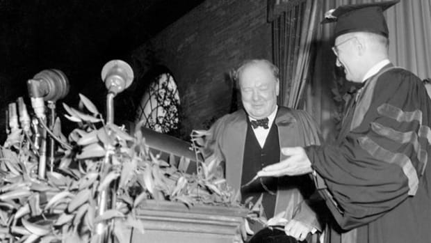 "On March 5, 1946, Winston Churchill receives an honorary degree from Westminster College in Fulton, Missouri. In a speech delivered on the occasion, Churchill introduces the phrase ""Iron Curtain"" to describe the division of power between the Eastern Bloc and the West, and warns against Soviet designs for expansion."