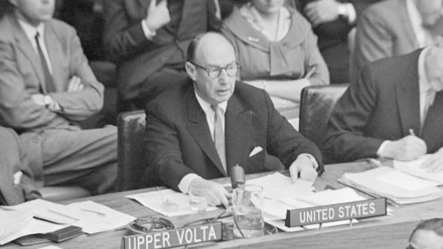 "On Dec. 1, 1961, U.N. Ambassador Adlai Stevenson debates the admission of the People's Republic of China (PRC) into the U.N. by pointing out the communists' ""impossible demands"" of expelling the Republic of China (ROC) from the U.N. and allowing China's takeover of Taiwan."