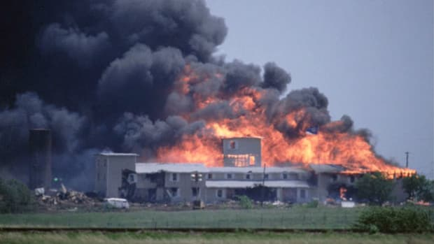 On April 19, 2003, after a 51-day standoff with Branch Davidian cult members and their leader David Koresh, the FBI opened a tear-gas assault on the cult's compound in Waco, Texas. A news report that evening describes the scene as the cult sets fire to its buildings, and FBI spokesman Bob Ricks reacts.