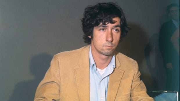 During a press conference on October 14, 1969, Tom Hayden, one of the defendants in the trial of the Chicago Seven, offers his view on prosecutor Thomas Foran's most recent accusations. The Chicago Seven—Abbie Hoffman, Jerry Rubin, David Dellinger, Tom Hayden, Rennie Davis, John Froines, and Lee Weiner—were charged with conspiracy and inciting to riot for their participation in the Vietnam War protests at the 1968 Democratic National Convention.