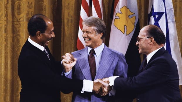 Learn about the contentious history between Israel and Egypt and President Carter's role in bringing both leaders — Israeli Prime Minister Begin and Egyptian President Sadat — to Camp David to establish a framework for peace in the Middle East.