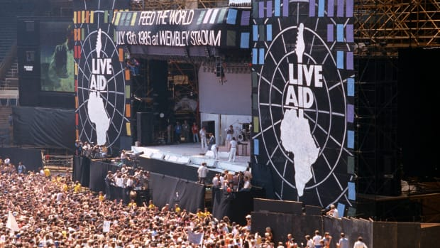 In a This Day in History video, learn that on July 13, 1985, the sixteen hour concert, Live Aid, was broadcasted around the world. Rock Musician Bob Geldof created the concert in attempt to raise money to relieve hunger in Africa. Live Aid was officially opened in London by Prince Charles and Princess Diana; the concert took place simultaneously in Philadelphia. Over a billion people watched some of rock's biggest acts: Queen, Mick Jagger, David Bowe, Madonna, and Ozzy Osborne. Live Aid raised over $125 million and Geldof was knighted by the Queen for his part.