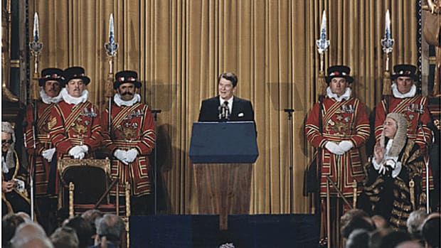 "On June 8, 1982, in the first speech by an American president to a meeting of both houses of the British Parliament, President Ronald Reagan presents his hope for a future that would ""leave Marxism-Leninism on the ash heap of history."""