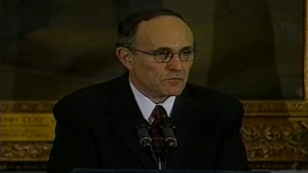 In this clip of Path to the Podium, the life of Rudy Giuliani is discussed.  Even though he was raised in Brooklyn, New York, and his father spent time in jail, he went on a different path starting at New York University. He went on to work for the US Attorneys office for the Southern District of New York making a difference in the activities of the mafia and on Wall Street. Then he became the mayor of New York City, or what some call him America's Mayor.