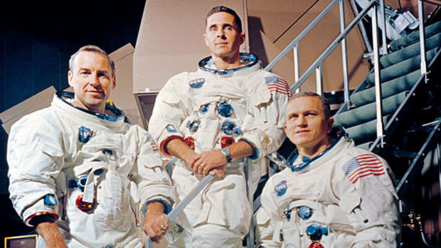 On December 24, 1968, astronauts Frank Borman, Jim Lovell and Bill Anders entered into lunar orbit aboard the Apollo 8 spacecraft. That evening, in a live radio and television transmission, Borman reads a passage from the Book of Genesis.